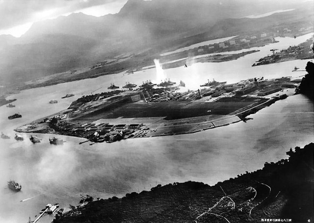 The attack on Pearl Harbor taken from a Japanese plane.  The picture shows the USS Oklahoma being struck by a torpedo.