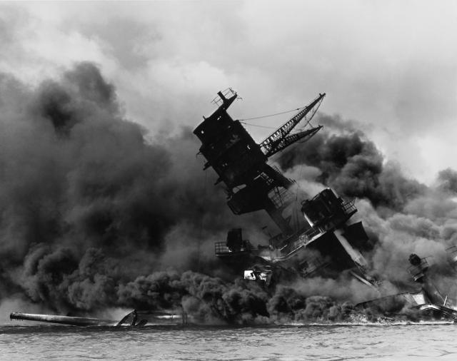 The USS Arizona burning as it sank.