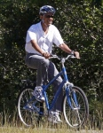 president-barack-obama-rides-along-bike-path-correllus-state-forest-martha-vineyard-west-tisbury-massachusetts