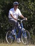 president-barack-obama-rides-along-bike-path-correllus-state-forest-martha-vineyard-west-tisbury-massachusetts