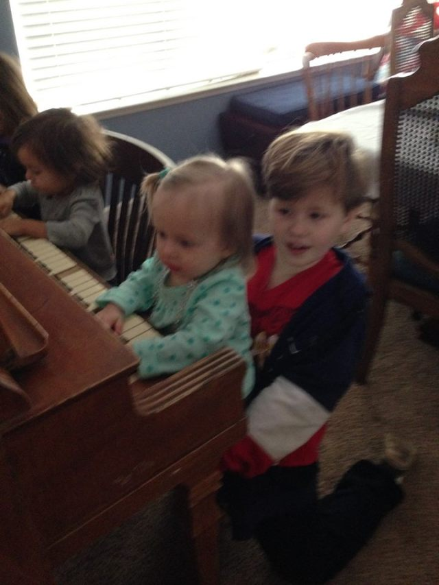 Lily and Mercy perform a piano duet.