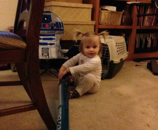 The young Padawan practices with her lightsaber.