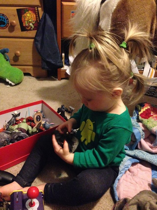 Lily plays with her brothers' action figures instead of dollies.